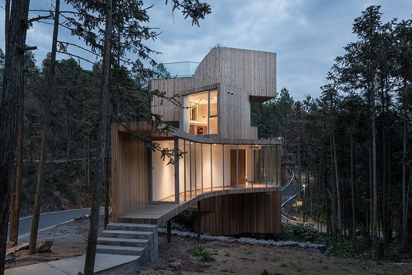 bengo studio's tree house hotel in china comprises a series of stacked timber volumes