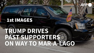 Trump drives by supporters on way to Mar-a-Lago | AFP