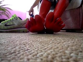 Boy feet latex socks with nike air max 2009 sneakers