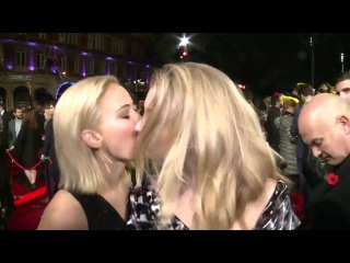 Jennifer Lawrence & Natalie Dormer kiss The Hunger Games Mockingjay Part 2 London premiere