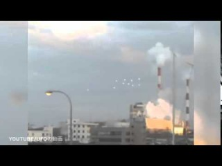 UFO sighting: Video captures 10 white globes floating in sky above Osaka in Japan