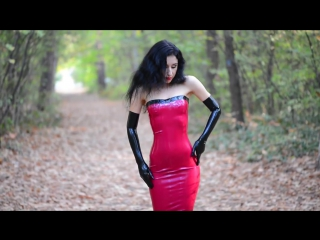 Marilyn yusuf wearing red latex dress and long gloves