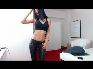Latina playing in wetlook leather leggings