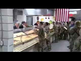 Commander-in-Chief of the US Military,President Trump,serves troops a Thanksgiving dinner during a surprise visit to Afghanistan