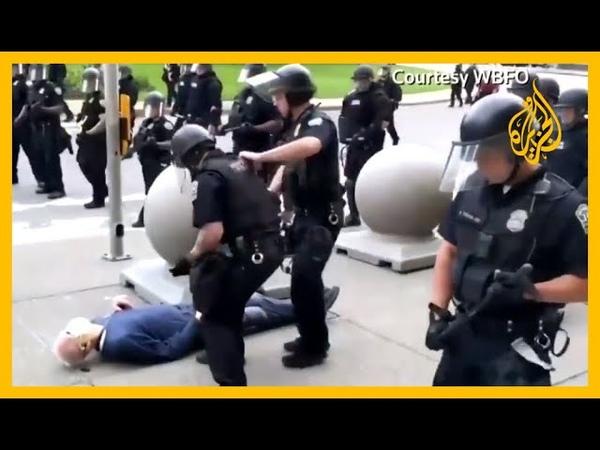 فيديو يظهر أفرادا من الشرطة بولاية نيويورك وهم يدفعون متظاهراً مسنا🇺🇸